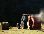 A hay baler using an ag belt to bale hay
