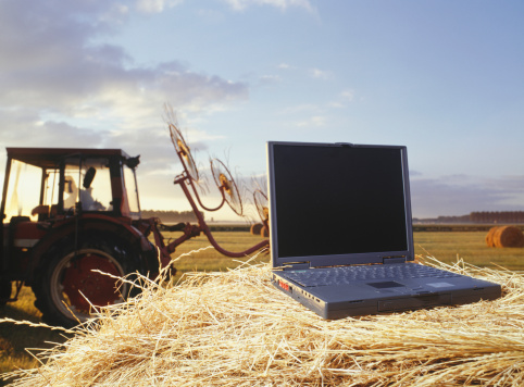 Laptop computer on a hay bale